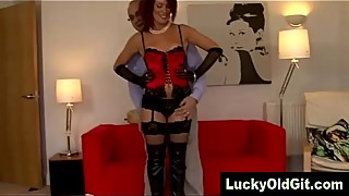 redhead in basque poses for olderman and wife