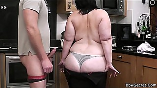 Cheating with huge lady on the kitchen